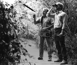 James L. Gulledge and Greg Budney (with binoculars) recording in Sapsucker Woods