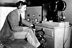 Cornell undergraduate M. Peter Keane with amplifier and film sound recorder inside the sound truck.